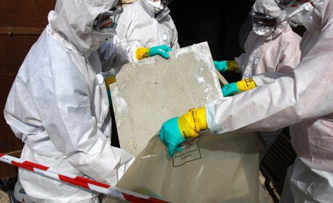 workers handling asbestos containing materials in personal protective equipment