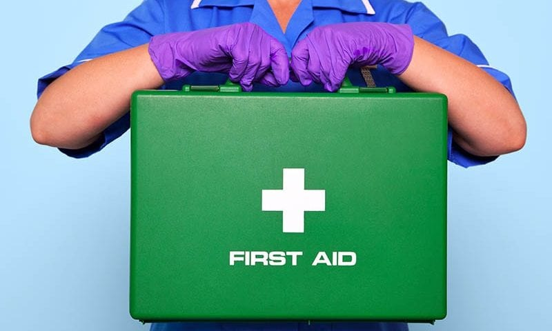 person holding a first aid kit who might be the appointed person