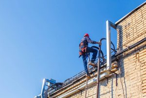 person climbing roof as part of a permit to work system