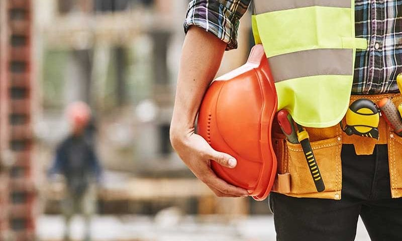 construction worker with hard hat and tools belt