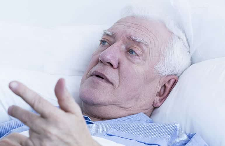 elderly resting in bed