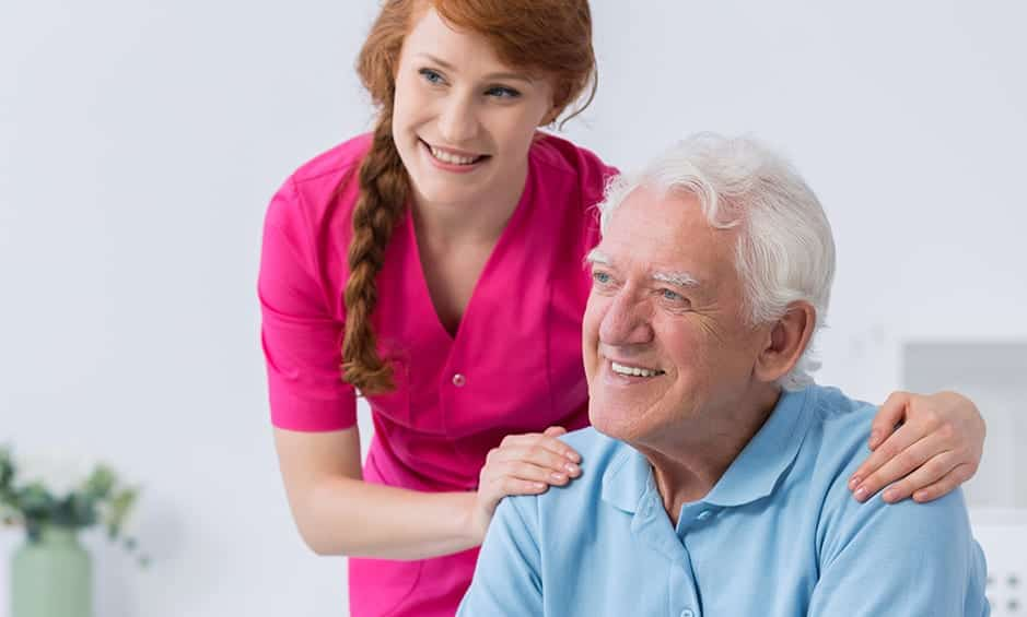carer and elderly are smiling